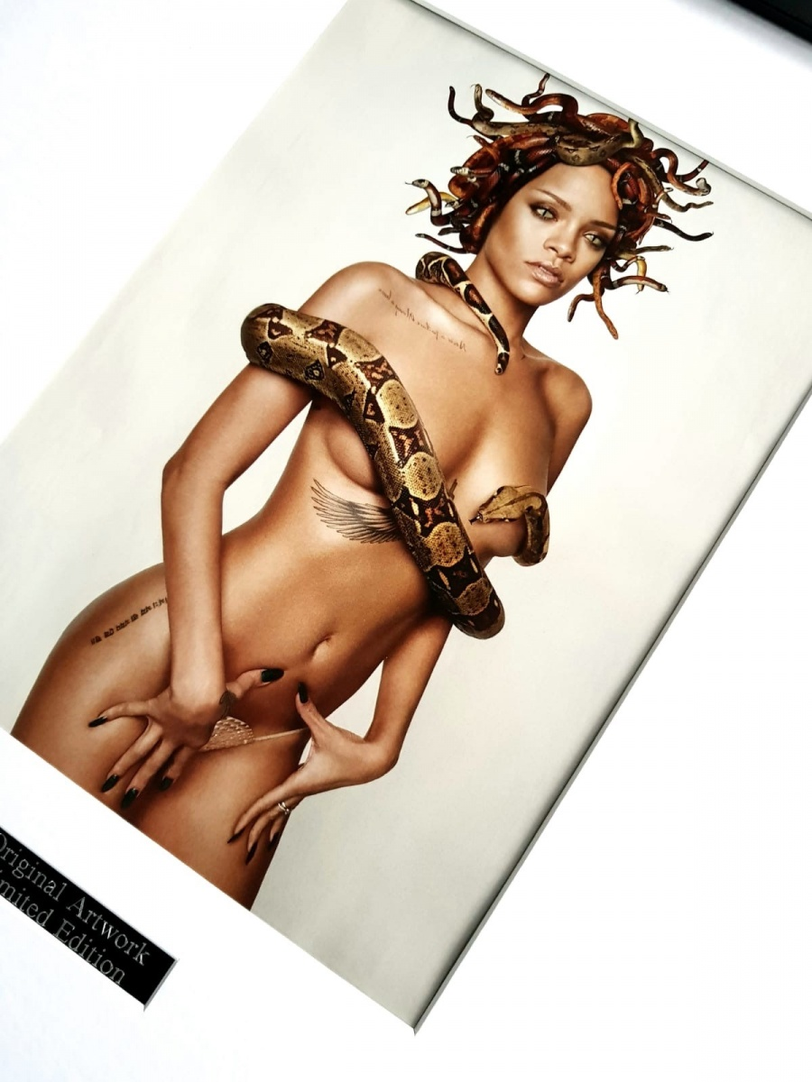 Rihanna poses topless & washes her crotch in new Esquire